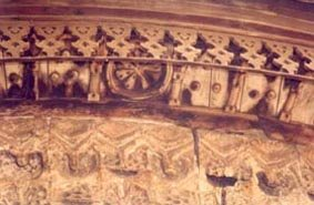 Deterioration of wooden canopy and stone stalactites rows